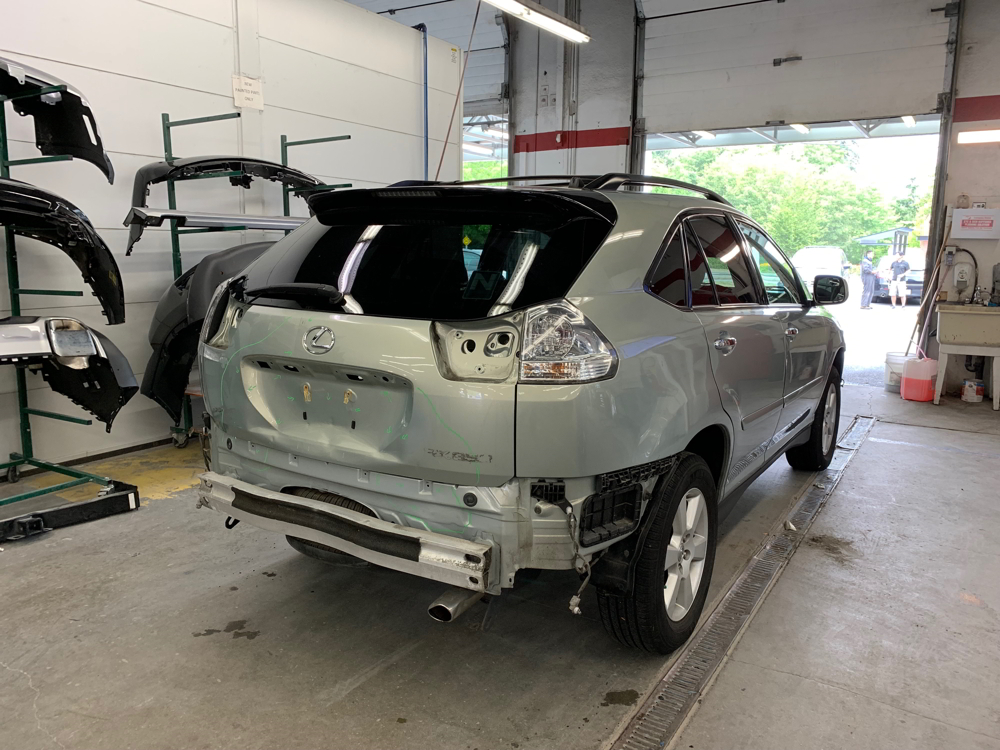 Back end of a Lexus SUV being repaired at Maximum Collision
