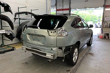 Small image of a Lexus SUV being repaired at Maximum Collision